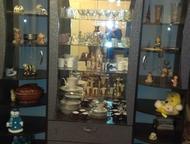 Кемерово: Стенка-горка Продам стенку, компактную, 220х170х70 в хорошем состоянии, стекла изогнутые, полки, ящики. Самовывоз.